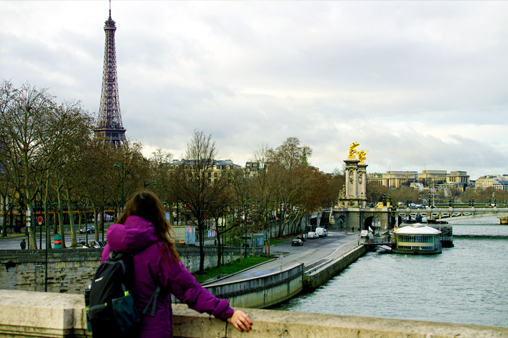 Surviving Europe: Excuses for Not Moving Abroad and How to Overcome Every One - Erin on Paris Bridge