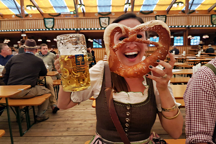 Surviving Europe: How to Plan a Last Minute Trip to Munich Oktoberfest - Erin with Pretzel