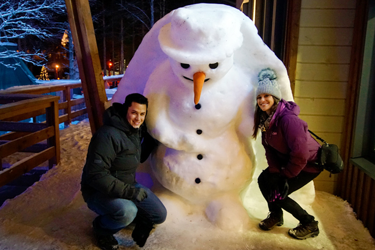 Surviving Europe: We Met Father Christmas at Santa Claus Village in Rovaniemi Finland - Us with Snowman