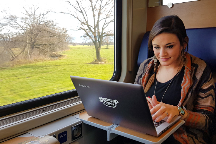 Surviving Europe: How to Follow Through on Your New Years Resolution to Travel - Working in a Train