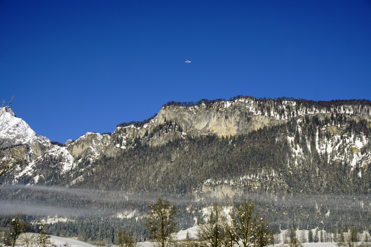 Surviving Europe: Hahnenkamm World Cup Ski Race in Kitzbuhel Austria - Plane Over Mountain