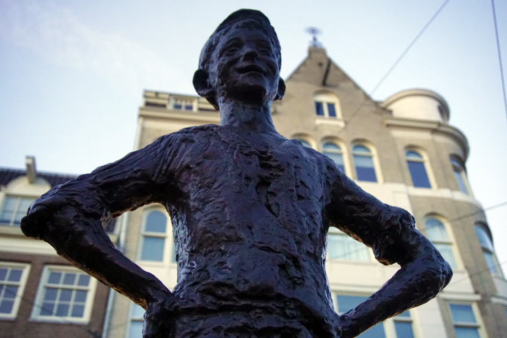 Surviving Europe: 7 Commitments to Make to Yourself Before Moving Overseas - Boy Statue